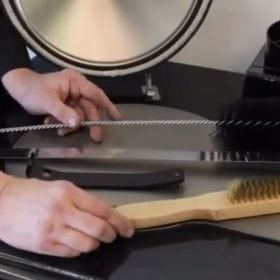 Cleaning an ESSE cooker wire brush