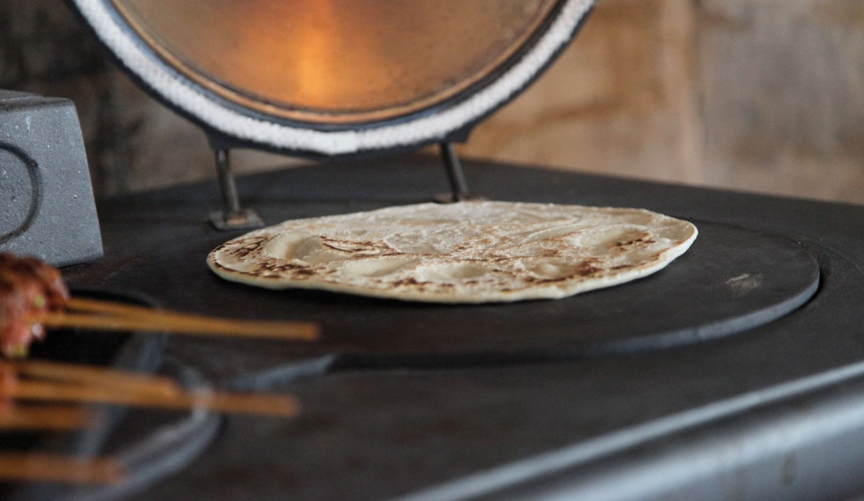 cooking chapatti on the cast iron hotplate