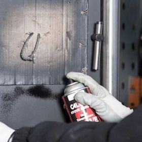 spraypainting a stove door