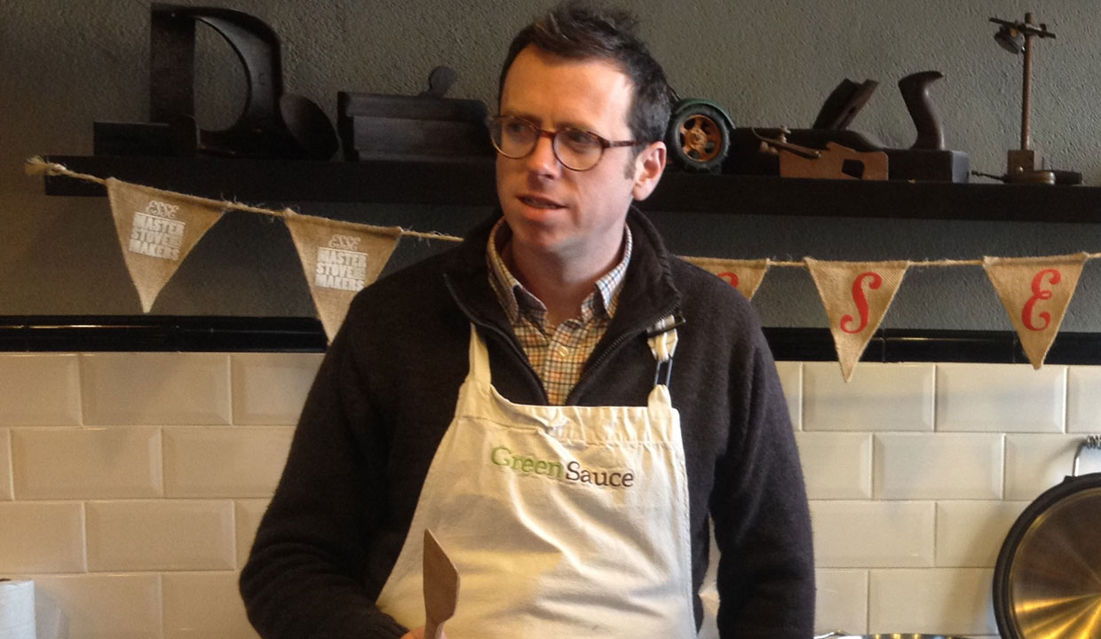 Tim maddams in an apron with an ESSE