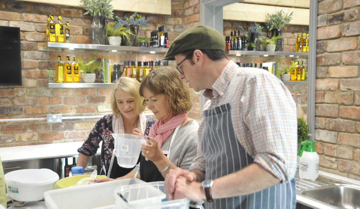 Tim maddams cooking demonstration with two ladies