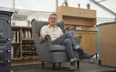 Hugh Fearnley Whittingstall sat in a chair next to an ESSE 990 ELX